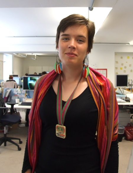 Me at the JustGiving offices showing off my marathon medal - check out those undereye shadows!